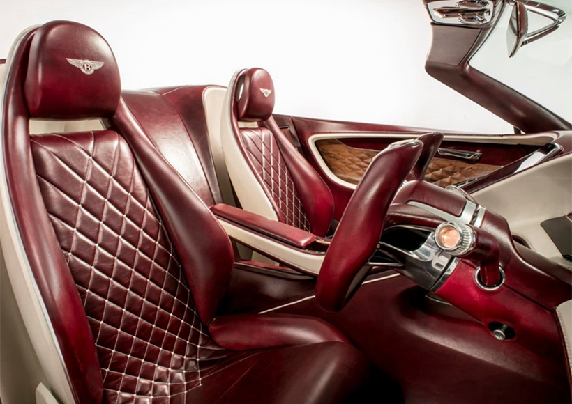和汽油动力的宾利轿车一样,这台电动概念车并没有在内饰用料上作出任何缩水,依然采用了顶尖的制造工艺。内饰大量使用圆弧线条,充满现代科技感。酒红色的配色也让这台车在视觉效果上更进一步。