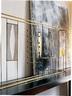 Fausto Melotti创作的几何形金属雕塑装饰了客厅的一角。