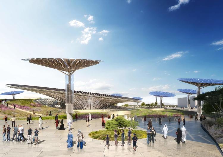"""在主建筑周围,还分布了一系列""""能源树""""(energy trees),会像向日葵一样,跟着太阳转动,高效地吸收太阳能。"""